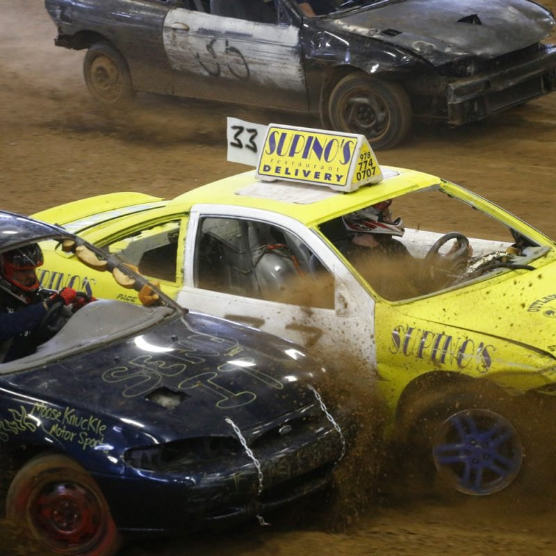 demolition derby cars crash into one another